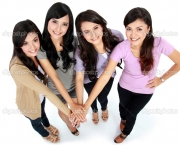 Group of beautiful women with their hands together